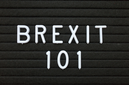 The words Brexit 101 in white plastic letters on a black letter board