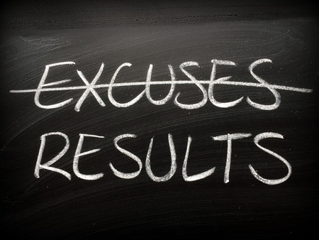 The word Excuses crossed out on a backboard and replaced with the word Results Stock Photo