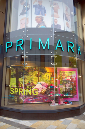 Bracknell, England - April 12, 2018: Window display and company name of the Primark retail store in Bracknell, England. Primark opened their first UK store in Derby in 1973