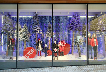 Bracknell, England - December 04, 2018: Winter clothing in the Christmas season, window display of Fenwick department store in Bracknell, England Editorial