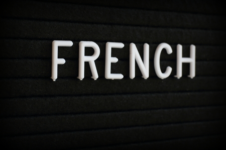 The word French in white plastic letters on a notice board Stock Photo