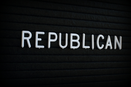 The word Republican in white plastic letters on a black letter board