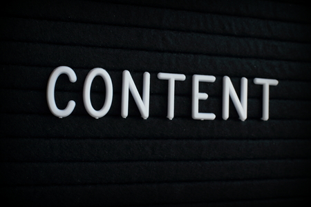 The word Content in white plastic letters on a black letter board Stock Photo