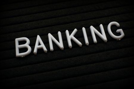 The word Banking in white plastic letters on a black letter board Stock Photo