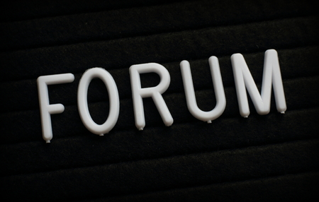 The word Forum in white plastic letters on a black letter board Stock Photo