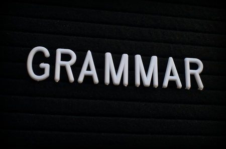 The word Grammar in white plastic letters on a felt notice board