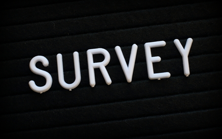 The word Survey in white plastic letters on a black letter board Stock Photo