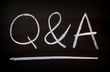 The letters Q & A written by hand in white chalk on a blackboard