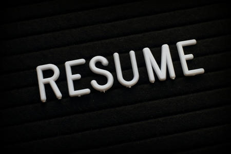 The word Resume in white plastic letters on a notice board