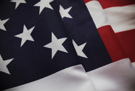 Partial view of the stars and stripes flag of the United States of America with vintage color effects applied