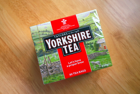 Bracknell, England - April 03, 2019: Unopened box of Yorkshire Tea bags on a wooden table top. Taylors of Harrogate have been providing tea in England since 1886 Editorial