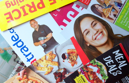 Bracknell, England - April 10, 2019: Sample of leaflets and brochures or Junk Mail delivered to a private address in Bracknell, England to advertise local retail and service businesses