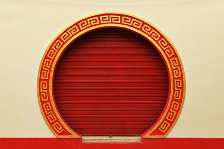 archway: red door of the chinese temple Stock Photo