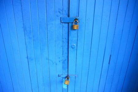 blue door with iron door locked  Stock Photo - 16507687
