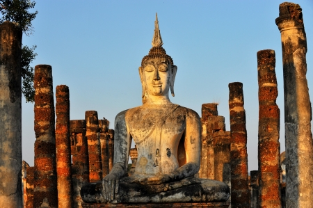 sukhothai: Buddha Statue in Wat Mahathat Temple in Sukhothai Historical park at sunrise, Thailand