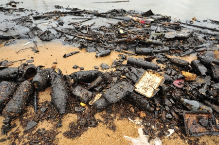 Oil spill  Contaminated Beach  Stock Photo