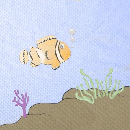 anemonefish: orange anemonefish cartoon made from tissue papercraft