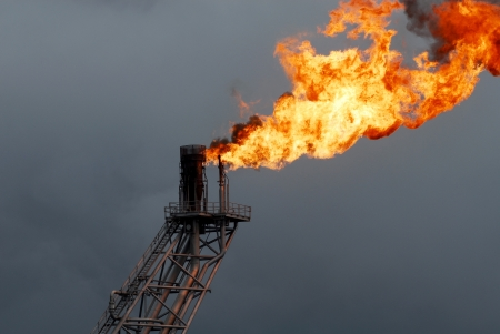 Flare boom nozzle and fire on offshore oil rig photo