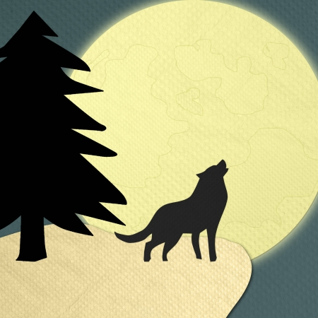 Wolf howling at the moon in the midnight made form tissue paper craft photo