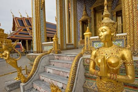 A Golden Kinnari statue in Wat Phra Kaew, Bangkok, Thailand photo