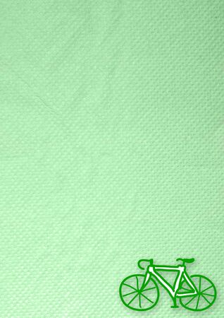 tissue papercraft: bicycle icon  on green background tissue paper-craft