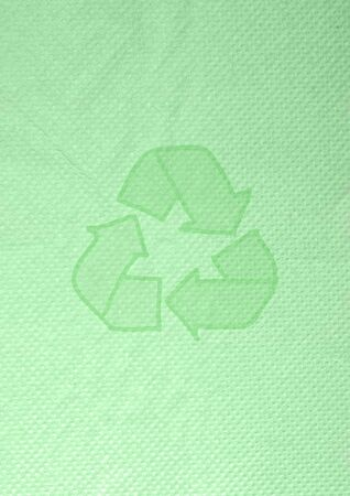 tissue papercraft:  recycle icon  on green background tissue paper-craft