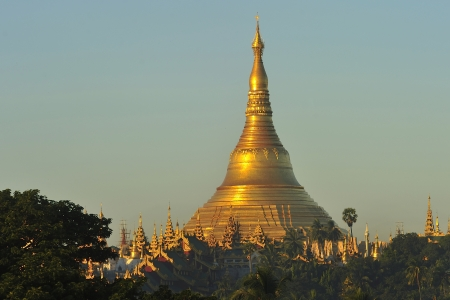 Shwedagon Pagoda Temple with village below in the morning light at Yangon, Myanmar  Burma  Stock Photo