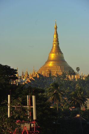 Shwedagon Pagoda Temple with village below in the morning light at Yangon, Myanmar  Burma  Stock Photo - 17209811