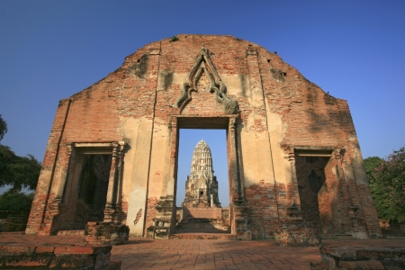 Wat Rajaburana gate and central tower in the background in Ayutthaya, Thailand  photo