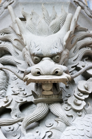 Dragon head carving near the Big Buddha in Hong Kong  Stock Photo - 17888159