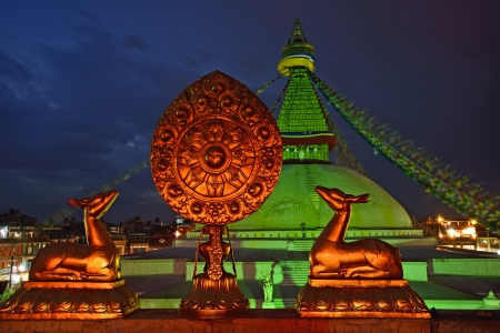 Golden brahma symbol in front of Boudha Nath  Bodhnath  stupa in kathmandu, Nepal  photo
