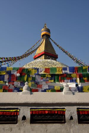 Buddhist Shrine Boudhanath Stupa with pray flags over blue sky. Nepal, Kathmandu  Stock Photo - 18777011