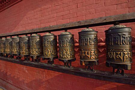 himalaya: prayer wheels at swayambhunath temple in kathmandu, nepal  Stock Photo
