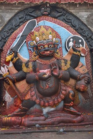 kali: Statue of hindu deity Shiva in the form of fearful Bhairab on Durbar Square in Kathmandu, Nepal  Stock Photo
