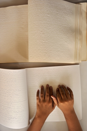 Blind reading text in braille language  Stock Photo - 18782873