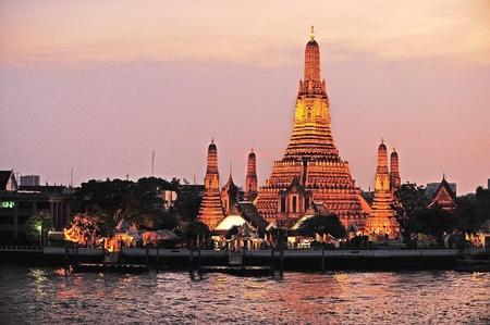 Wat Arun, The Temple of Dawn, at twilight, view across Chao Phraya river  Bangkok, Thailand   photo