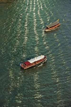 boat and sunlight reflection with Chao Phraya river, Thailand  photo