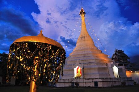 Wat Phra That Doi Kong Mu in twilight. Mae Hong Son, Thailand  photo