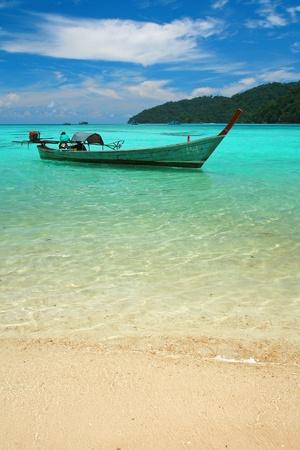 surin: Andaman Seascape with boat, mountain, white sand and blue sky, mu ko surin, thailand