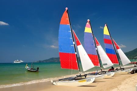 sail boat on patong beach, phuket, thailand  photo