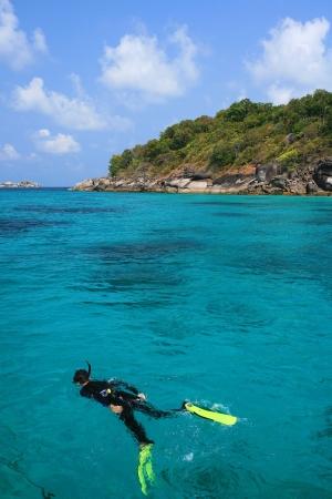 snorkelers: snorkeling in crystal blue water, Similan island, Andaman Sea, Thailand  Stock Photo