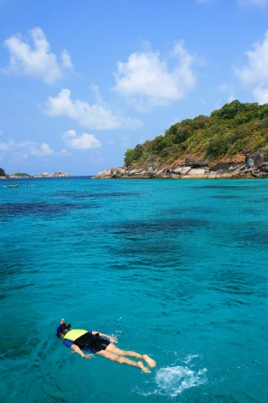 snorkeling in crystal blue water, Similan island, Andaman Sea, Thailand  photo