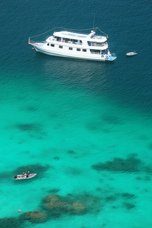 Luxery cruise on clear water  at Similan island south of Thailand.  photo
