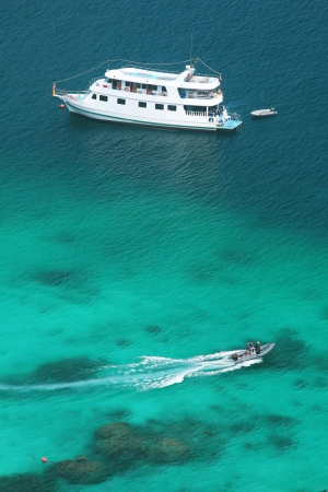 snorkelers: Luxery cruise on clear water  at Similan island south of Thailand.  Stock Photo