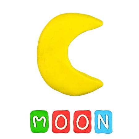 Lune de pâte à modeler couleurs des enfants sur un fond blanc