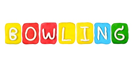 Colorful plasticine alphabet form word BOWLING photo