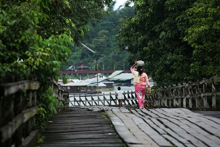 old an long wooden bridge at Sangklaburi,Kanchan aburi province, Thailand  photo