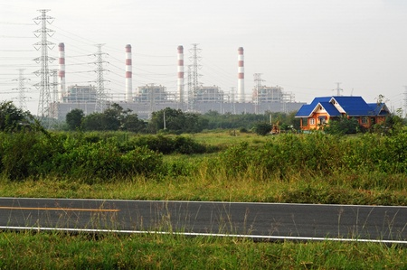 House and electricity towers  photo