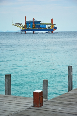 celebes: A view of resort made form old rig of Mabul in the middle of sea celebes ocean