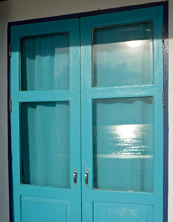 Saturated blue windows wih reflect sunlight photo